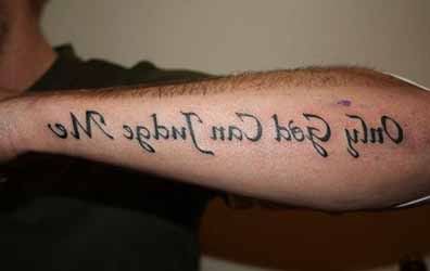 tatouage-homme-bras-ecriture.jpg
