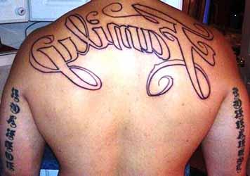 tatouage-tribal-haut-du-dos-homme.jpg